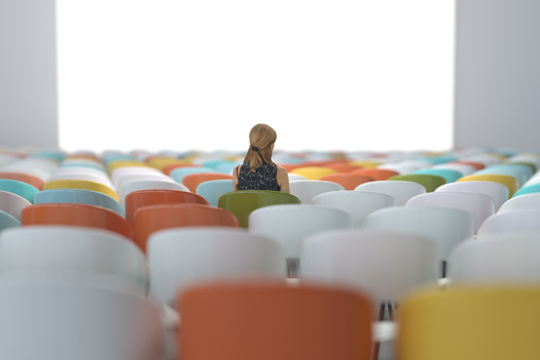 woman sitting in a conference hall